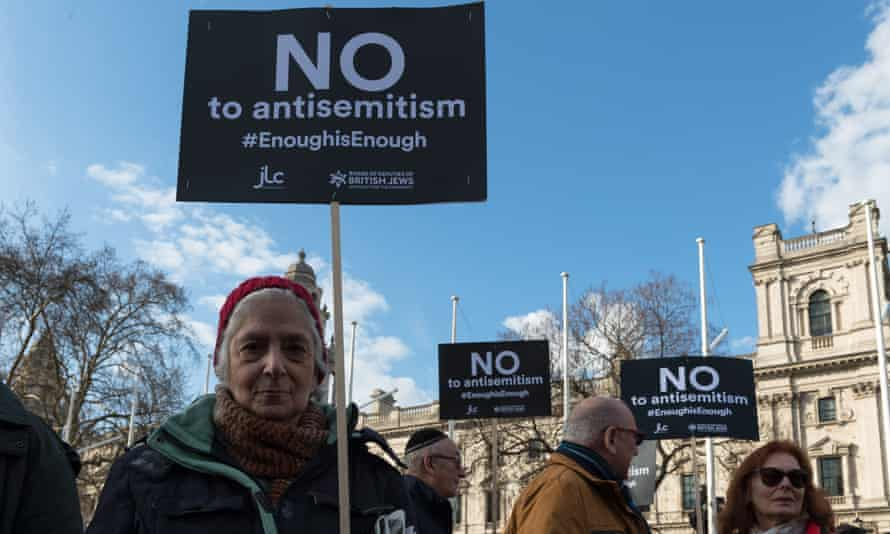 Protesters campaign against antisemitism within the Labour party in Parliament Square in London.