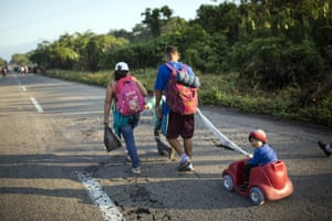 Central American migrants traveling with a caravan to the U.S. make their way to Mapastepec, Mexico, Wednesday, Oct. 24, 2018