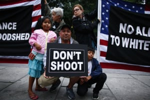 A man holds a banner during a protest in New York