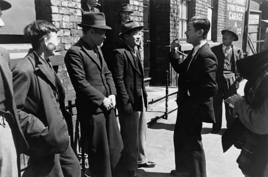 A group of Chinese seamen outside a Chinese hostel in Liverpool, May 1942.