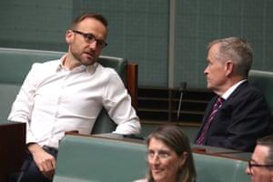 Greens leader Adam Bandt talks with Bill Shorten during a division