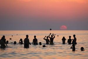 The sun sets at Cava D'Aliga in Sicily, Italy