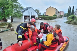 Simbach am Inn, southern Germany Rescue workers save people with a boat out of their flooded house