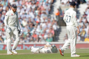 Australia's Steve Smith lies on the pitch after diving for the crease, much to the amusement of England's Jonny Bairstow.