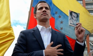 """Juan Guaido declares himself """"acting president"""" during a rally against leader Nicolas Maduro."""
