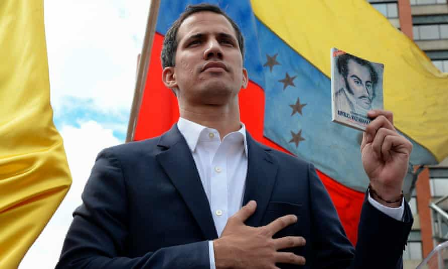 "Juan Guaido declares himself ""acting president"" during a rally against leader Nicolas Maduro."