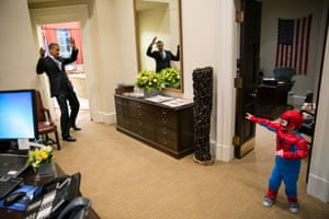 October 26: 'The president pretends to be caught in Spider-Man's web as he greets Nicholas Tamarin, three, just outside the Oval Office. Nicholas had been trick-or-treating with his father, White House aide Nate Tamarin, in the Eisenhower Executive Office Building. I can never commit to calling any picture my favorite, but the president told me that this was his favorite picture of the year when he saw it hanging in the West Wing a couple of weeks later'