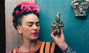 Frida Kahlo with an Olmec figurine in 1939.