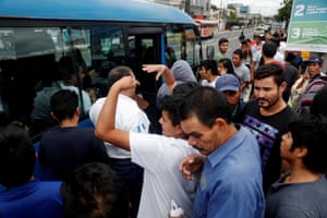 Guatemalan migrants recently deported from the United States enter a free bus that will take them to the department of Huehuetenango.