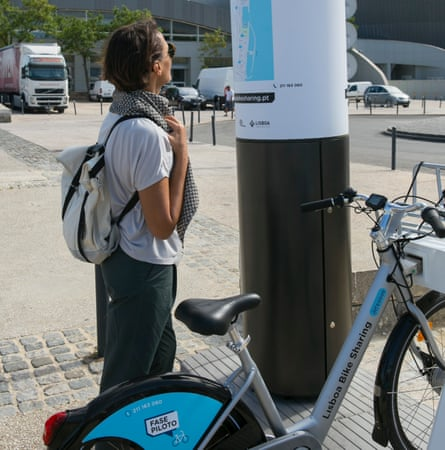 A user gets ready to hire one of Lisbon's new e-bikes.