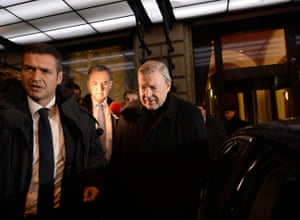 Cardinal George Pell leaves the Quirinale hotel in Rome
