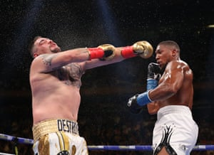 Joshua connects, stunning Ruiz and he goes down in the first.