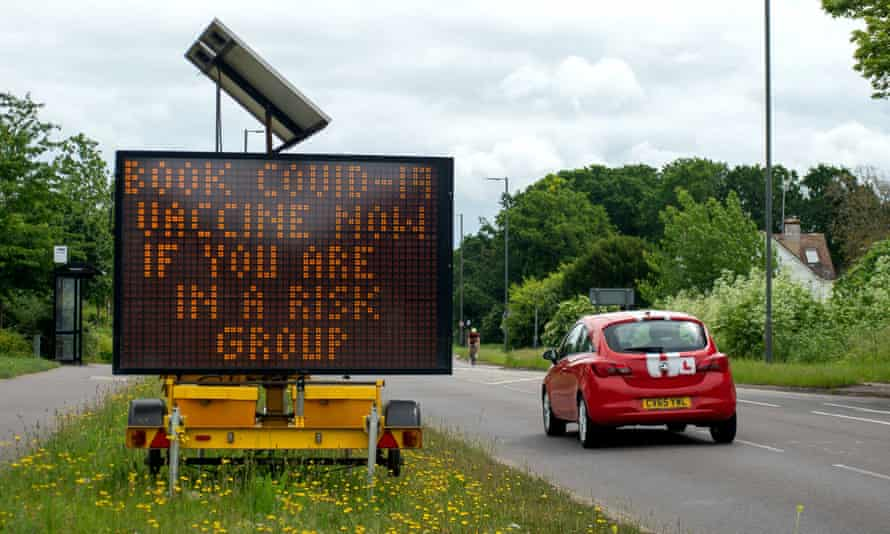 A roadside sign in Buckinghamshire encourages at-risk people to get their Covid vaccination