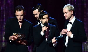 The 1975 accept the award for British album of the year.