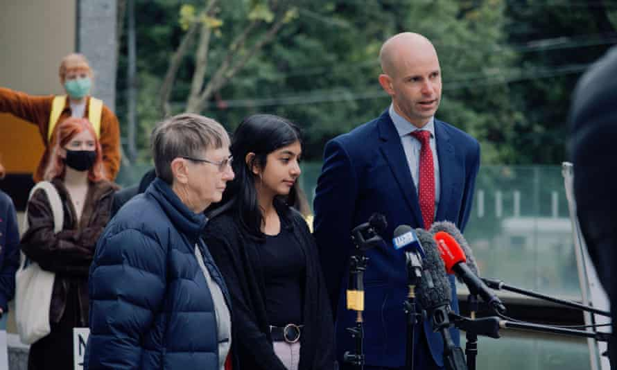School student Anjali Sharma outside the federal court in Melbourne , with lawyer David Barndam and court guardian Sister Brigid Arthur.