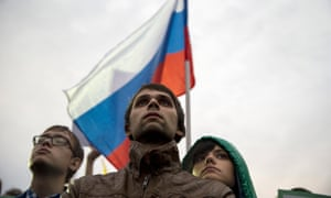 A young couple attend an opposition rally in Moscow