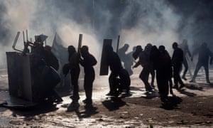 Demonstrators clash with riot police for a fourth straight day on Monday.