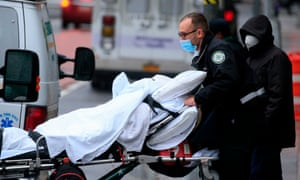 A patient is transported outside of Tisch hospital in New York on 13 November