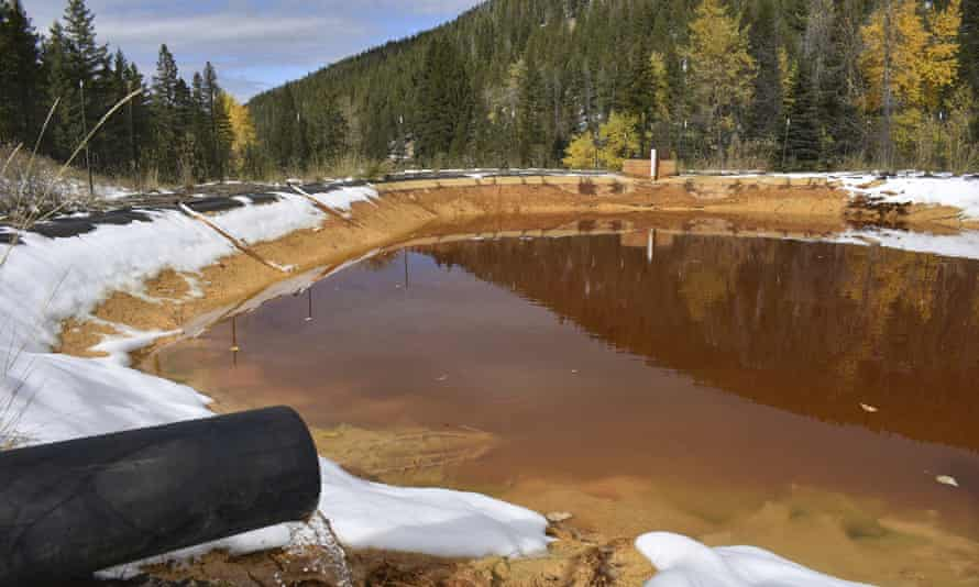 Water contaminated with arsenic, lead and zinc flows from a pipe out of the Lee Mountain mine and into a holding pond near Rimini, Montana, part of the Upper Tenmile Creek Superfund site.