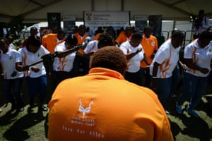 Local choir members wear T-shirts with 'Save Our Rhinos' slogan perform during the World Wildlife Day celebration at the Kruger national park in Mpumalanga, South Africa