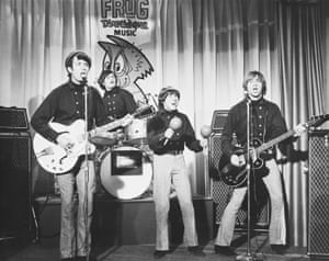 Peter Tork, far right, performing with the Monkees, from left, Michael Nesmith, Micky Dolenz and Davy Jones, in the 1960s.
