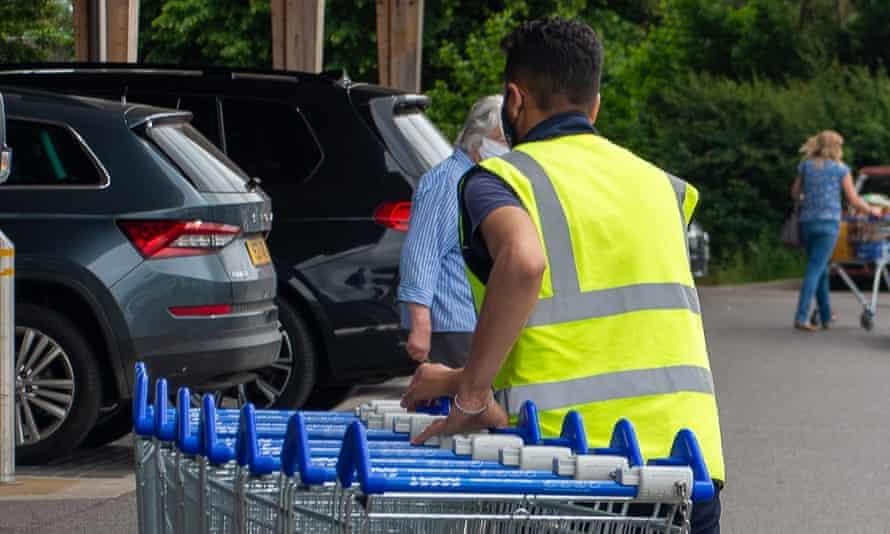 A supermarket worker in England.