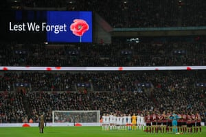 The teams stand for a minute's silence for Remembrance Sunday.