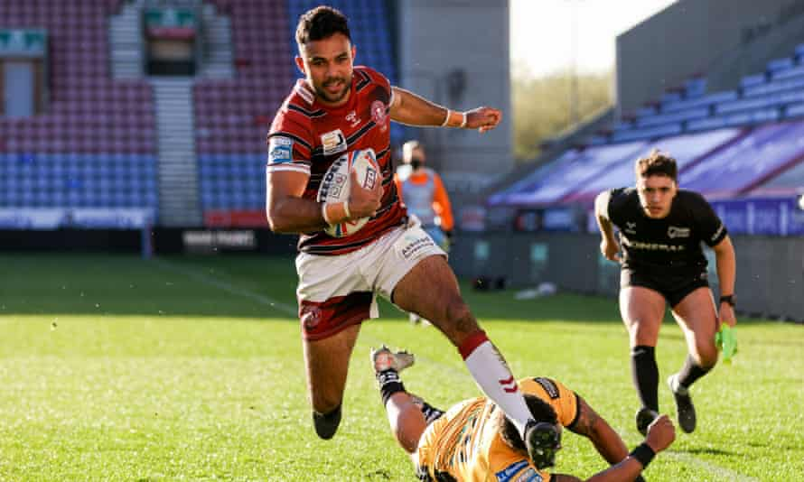 Wigan's Bevan French runs in for a try against Castleford.
