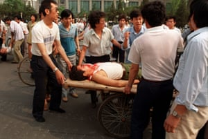 Local residents loaded two wounded people on a rickshaw flatbed shortly after PLA soldiers opened fire on a crowd in this June 4, 1989.