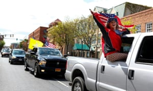 Demonstrators drive though downtown Annapolis, Maryland.