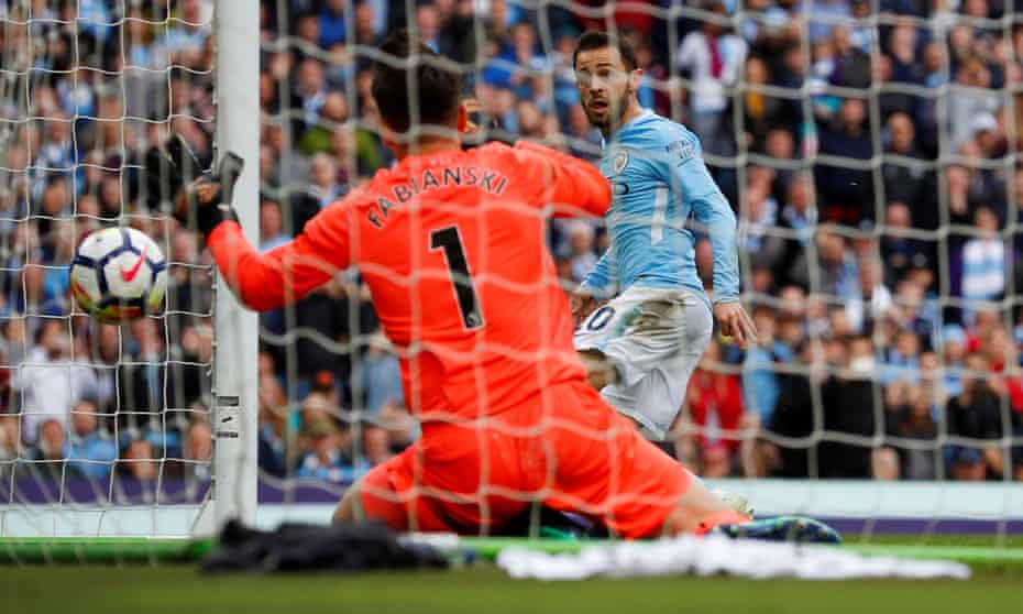 Manchester City's Bernardo Silva scores against Swansea City