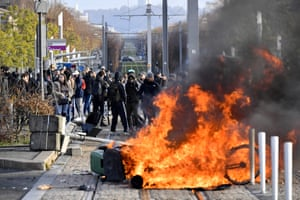 Students set a barricade on fire during an anti-government protest in Bordeaux, France