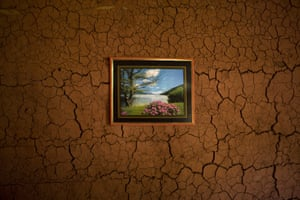 A picture hangs on the wall inside an artisanal diamond miner's home in Areinha, Minas Gerais state, Brazil