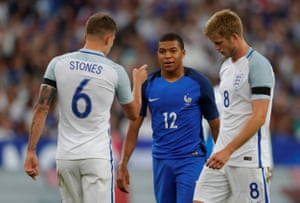 John Stones remonstrates with Kylian Mbappe after Stones had held him back.