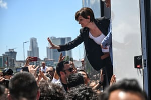 Istanbul, Turkey Republican People's Party Istanbul chief Canan Kaftancioglu waves to supporters as she stands on a stage to deliver a speech after her trial in Istanbul. She faces up to 17 years in prison for allegedly 'insulting the Turkish President' in tweets posted between 2012 and 2017. The trial will resume in September