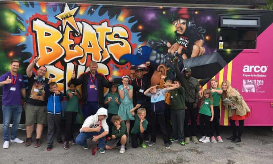 Adults and children in front of the Beats Bus in Hull