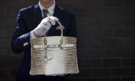 An employee holds a Hermes diamond and Himalayan Nilo Crocodile Birkin handbag at Heritage Auctions offices in Beverly Hills, California.