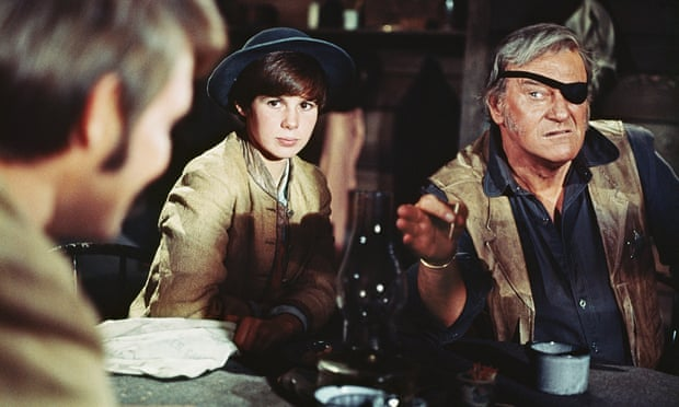 Kim Darby and John Wayne in True Grit. Wayne called Marguerite Roberts' script the best he'd ever read.