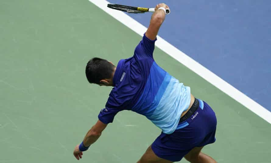 Novak Djokovic smashes his racket in frustration.