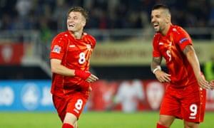 Macedonia's Ezgjan Alioski (left) celebrates scoring their fourth goal with fellow goalscorer Aleksandar Trajkovski.