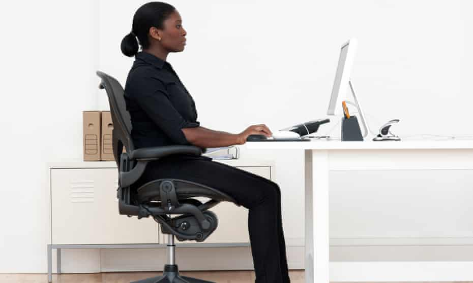 A woman at her desk.
