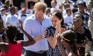 The dancing duke: Prince Harry and the Duchess of Sussex Royal in Nyanga township, Cape Town, on their first visit to South Africa in September 2019