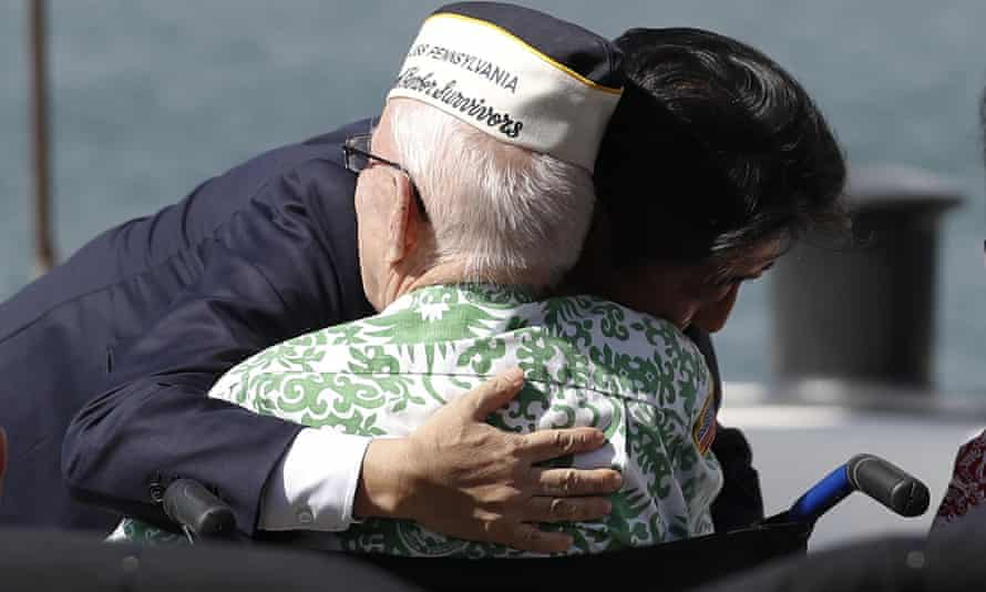 Shinzo Abe embraces a second world war Pearl Harbor survivor after he and Barack Obama spoke on Kilo Pier, overlooking the USS Arizona Memorial.