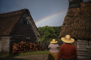 Museum educators playing the role of pilgrims look at a rainbow at a living history museum village in Plymouth, Massachusetts, US