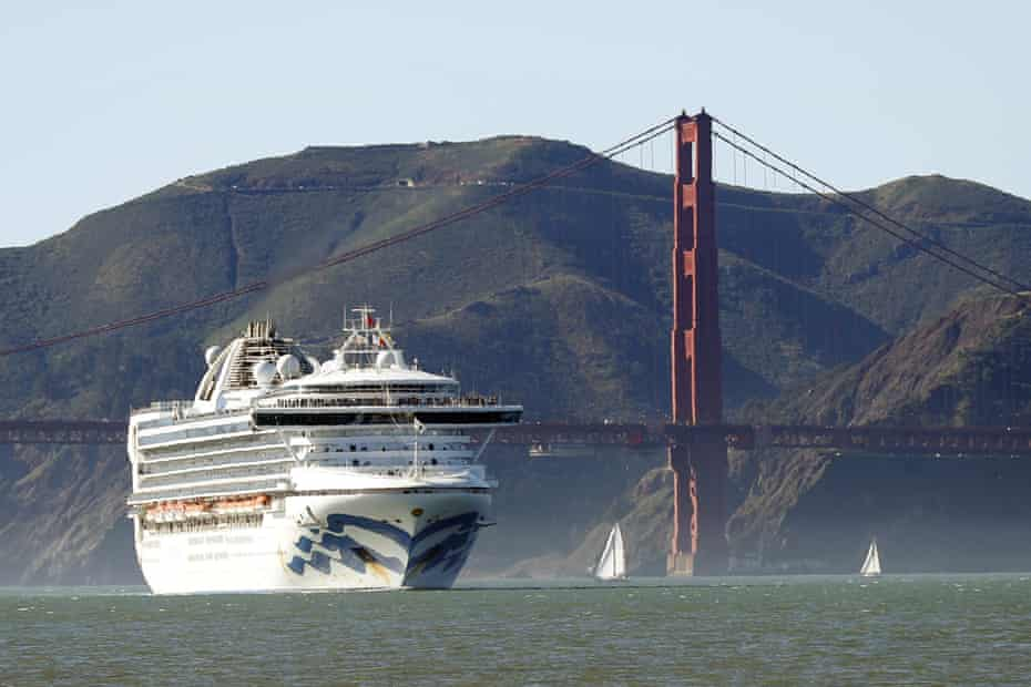 The Grand Princess cruise ship passes the Golden Gate Bridge in San Francisco on 11 February 2020 as it arrives from Hawaii.
