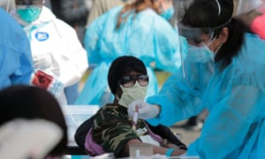 A Detroit resident is tested for coronavirus in Detroit, Michigan on Tuesday.