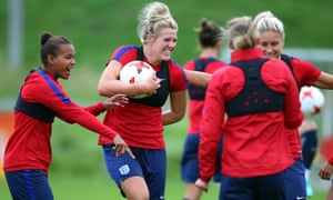 Millie Bright, centre, with her team-mates during England training on Saturday.