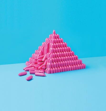 illustration of pink lipsticks in a pyramid against a blue background