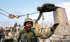 Baghdad 2003: US Marines help Iraqi civilians pull down a statue of Saddam Hussein near the Palestine Hotel.