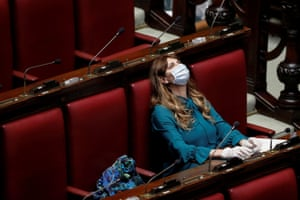 Maria Teresa Baldini of the far-right Fratelli d'Italia (Brothers of Italy) party wears a protective mask and gloves inside parliament after Italy's lockdown.